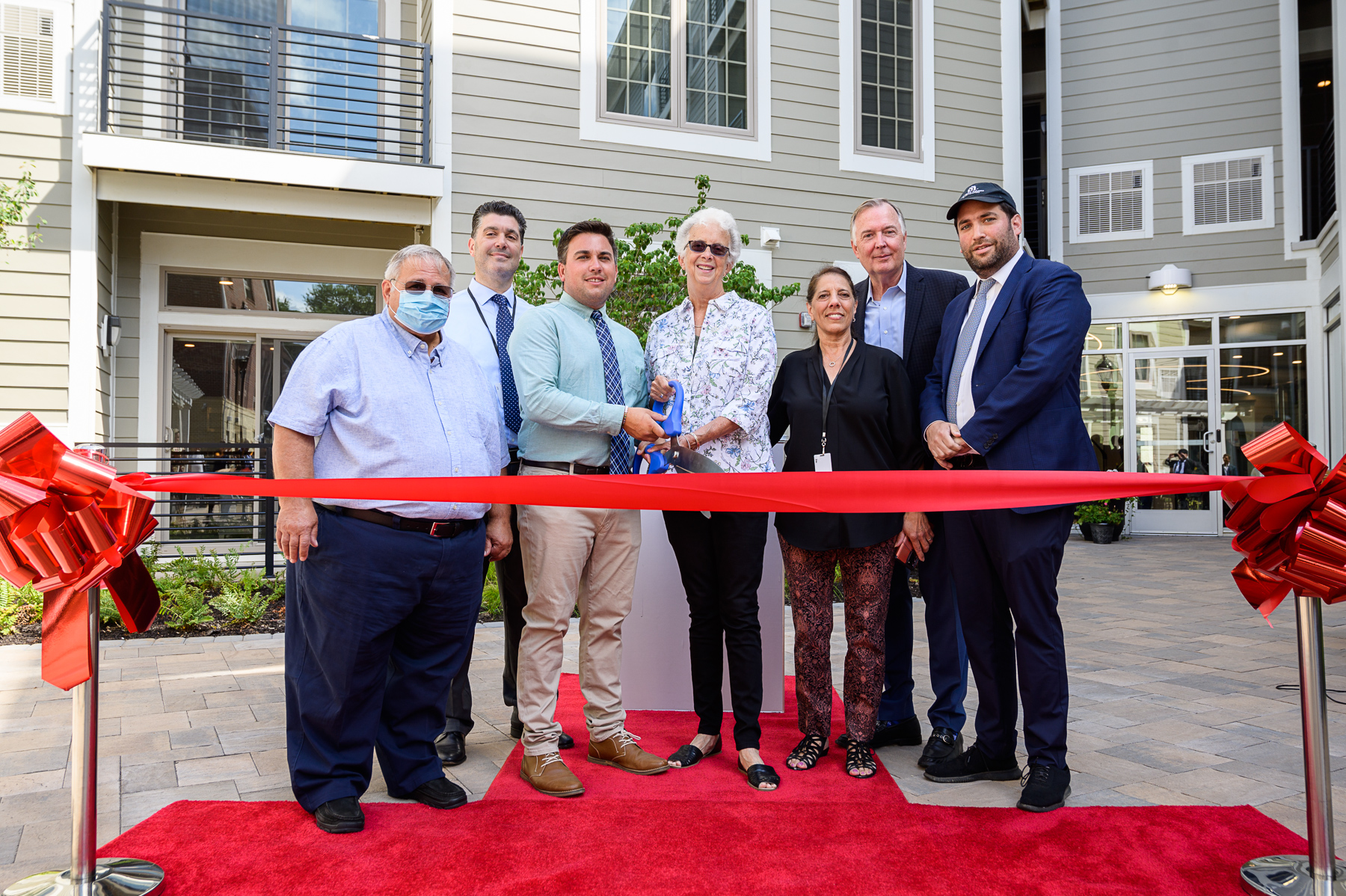 Raritan Mayor Zachary Bray joins Accurate Builders and Developers to celebrate successful debut of Crossings at Raritan Station